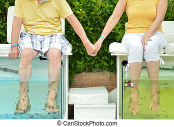 Couple at Fish spa skin treatment - Procedure for foot care...