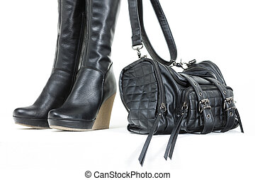 fashionable platform black boots with a handbag
