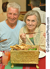 Senior couple at restaurant