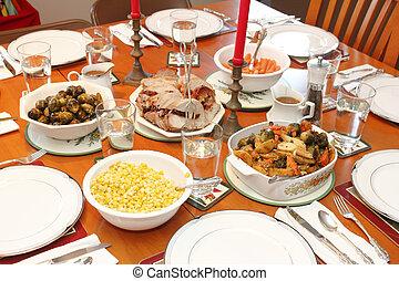 Christmas Dinner - Festive dinner table set with dinnerware...