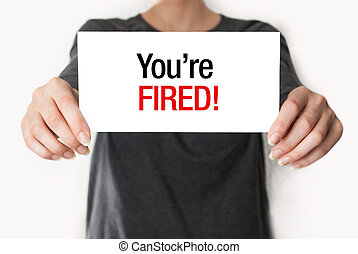 Youre fired card - Business woman holding a card with youre...