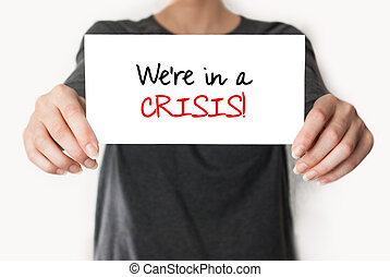 We're in a crisis - Girl holding or showing a card with text...