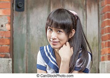 Asian schoolgirl in uniform outside school - Chinese student...