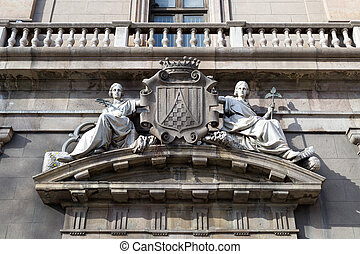 Two maidens on the facade of an old building