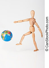 Wood mannequin kick a world globe in disrespect isolated on...