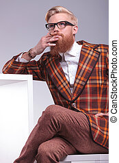 fashion man with beard smoking and looking away - smoking...