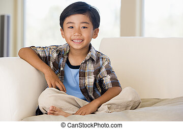 Young boy in living room smiling