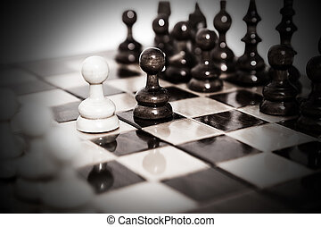 Chess board after first move - wooden chess pieces