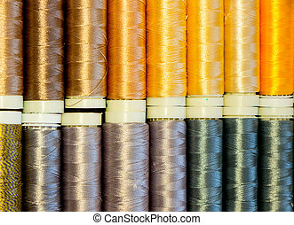 Colored spools of threads.