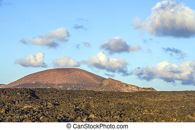 vulcanic landscape under the extincted vulcano in Timanfaya...