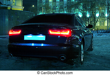 car at winter night - black car at winter night in the...
