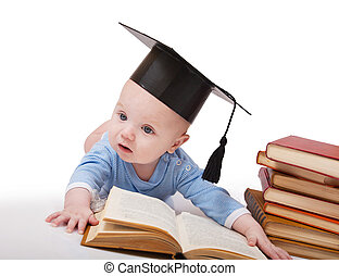 Baby in a hat of the bachelor and the book Concept of early...