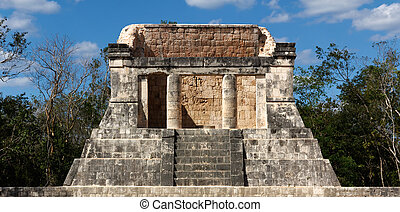 Mayan Ruin at Chichen Itza - Ruined Mayan dais rises above...