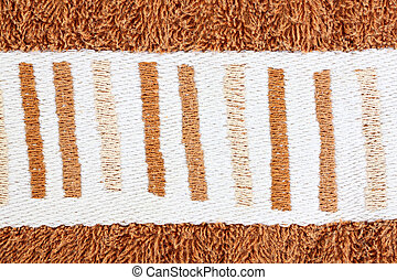 White Pattern on brown towels.