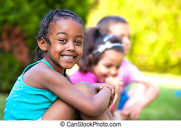 Outdoor portrait of a Adorable little African American girl...