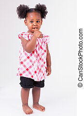 Cute little african american girl, isolated on white...