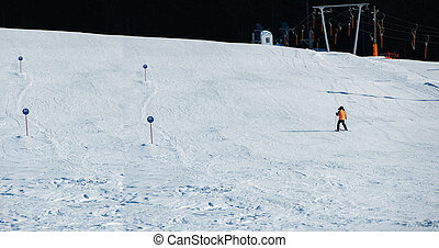 Man skiing down an open slope