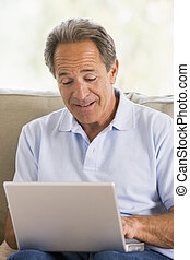 Man in living room with laptop