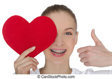 Happy girl with braces and heart isolated on white