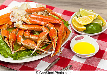 Crab legs - Snow Crab legs with fresh lemon slices and...