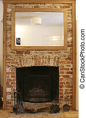 fireplace - old brick fireplace in renovated house in...