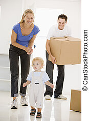 Family moving into new home smiling