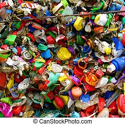 mosaic of plastic bottle tops in recycling plant in Germany