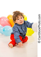 Toddler boy with balloons - Toddler boy in elegant clothes...