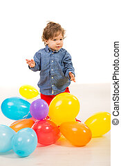 Elegant baby boy with balloons - Elegant baby boy playing...