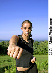 punch - fist - attractive young woman practicing self...