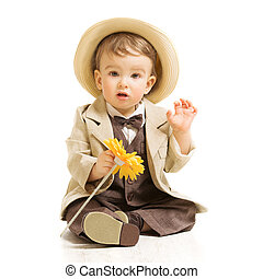 Baby boy well dressed in suit with flower. Vintage children...