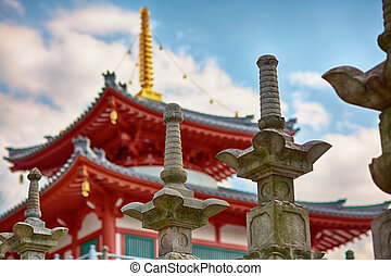 Buddhist temple - Stone lanterns and buddhist temple under...