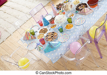 Birthday party table setting with food