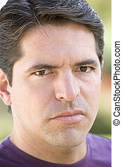 Head shot of man scowling