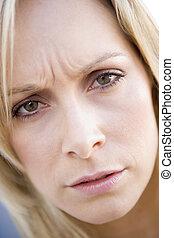Head shot of woman scowling