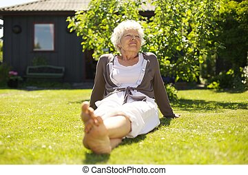 Senior woman enjoying the fresh air in garden