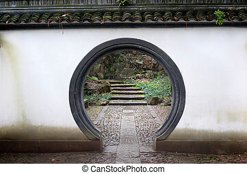 Traditional Chinese rounded doorway on Beishan Hill, Hangzhou, China