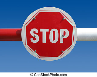 Red stop sign on a barrier.