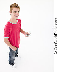 young boy holding cellular phone and smiling