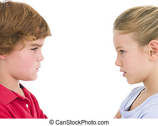 Brother and sister staring at each other