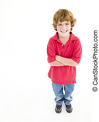 Young boy with arms crossed smiling