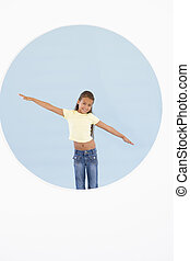 Young girl standing with arms out smiling