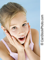Young girl excited and surprised