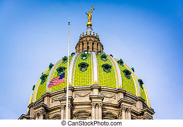 The dome of the Pennsylvania State Capitol in Harrisburg,...