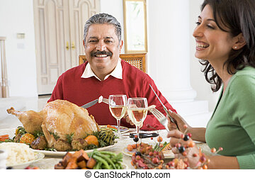 Father And His Adult Daughter Sitting Down For Christmas Dinner