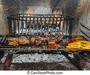 meat and vegetables are cooked on the grill in a large fireplace in the restaurant