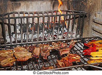 meat and vegetables are cooked on the grill in a large fireplace in the restaurant in Italy