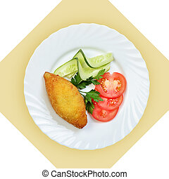 chicken Kiev cutlet with vegetables on white plate.