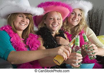 Dressed Up Teenage Girls Enjoying Drinks