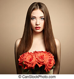 Portrait of beautiful dark-haired woman with flowers Fashion...